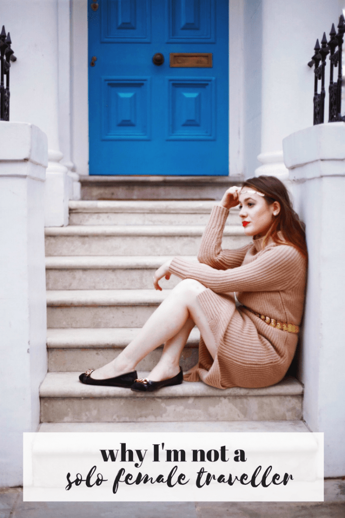 girl in beige knitted dress sitting on doorstep in notting hill london