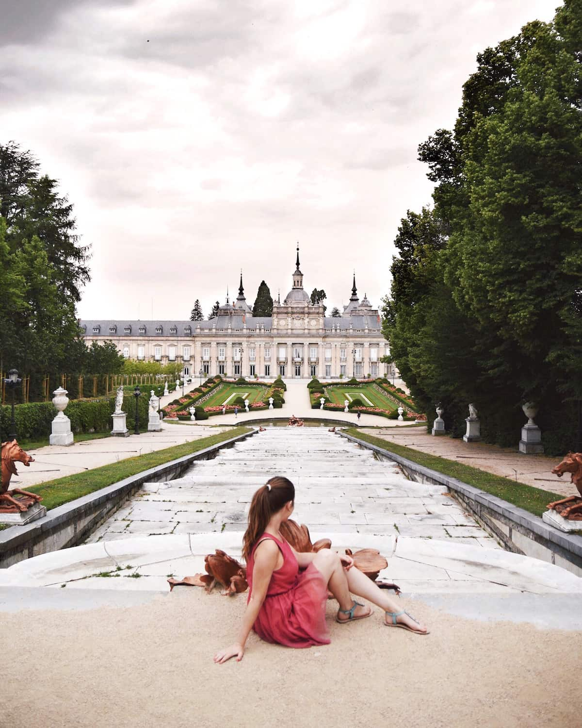 La Granja de San Ildefonso with girl in pink dress
