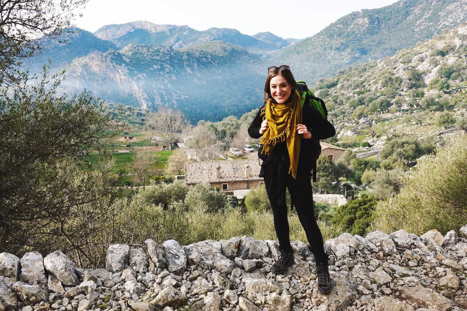 view of tossals verds female backpacker mallorca serra de tramuntana